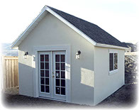 custom shed with stucco and doors